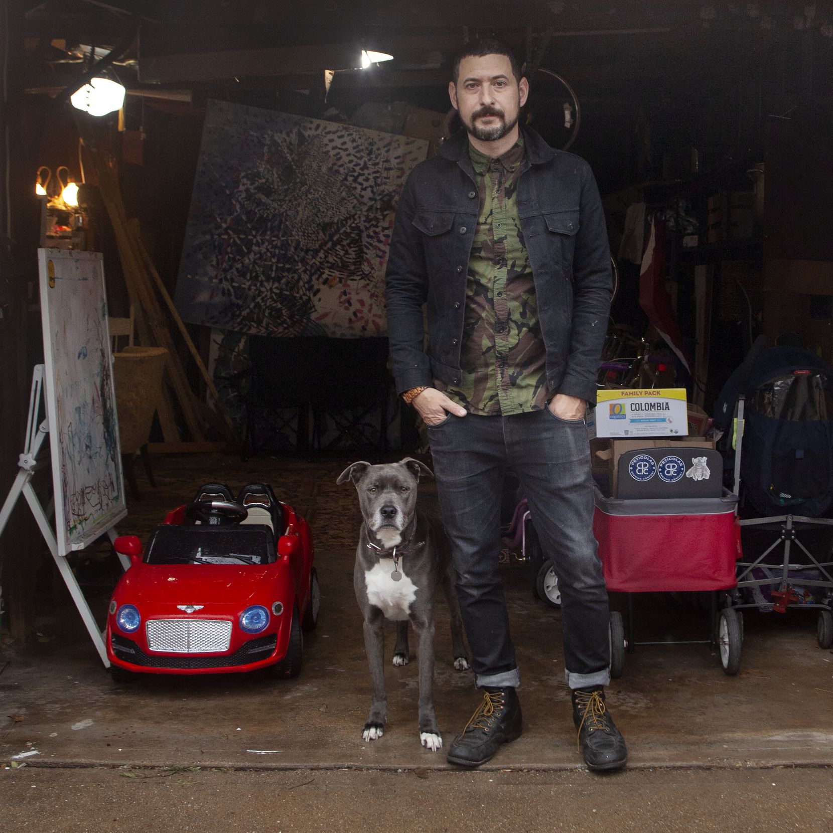Artist Nic Mathis with his dog Max, photographed in his studio in Dallas on Jan. 22, 2019.
