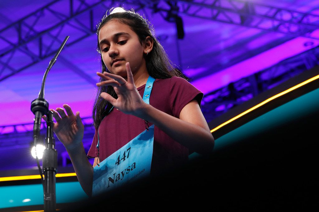 Naysa Modi, 12, from Frisco types her word in the air while spelling correctly during the evening finals of the Scripps National Spelling Bee in Oxon Hill, Md.,  in  2018.