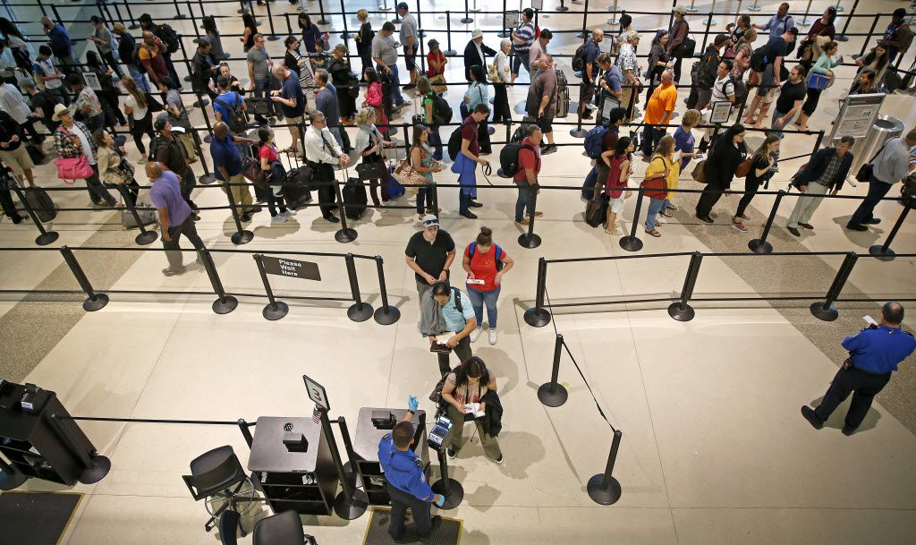 People stand in line to go through the TSA security checkpoint at Dallas Love Field in Dallas, Tuesday, May 17, 2016. (Jae S. Lee/The Dallas Morning News)