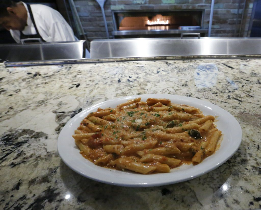 Penne ala Vodka, photographed Monday December 14, 2015, from the lunch menu of the new Coal Vines, located across from the Omni Dallas Hotel. A Dallas favorite combining fresh cream, tomato sauce and vodka with red onion, Shallots and herbs and finished with fresh imported parmesan. (Ron Baselice/The Dallas Morning News)