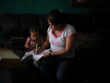 Lucia, 38, from Guerrero state, draws with her youngest daughter as she waits with her children at Agape World Mission shelter for a chance to request asylum in the United States, in Tijuana, Mexico on Sept. 13, 2019. Lucia fled with her children after her teenage daughter was attacked and gang-raped on the way to school, leaving her pregnant with twins.