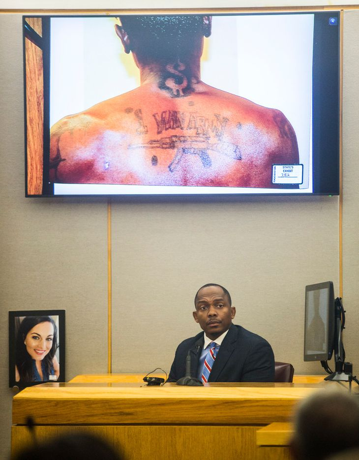 Dallas homicide detective Eric Barnes describes photos of Kristopher Love's tattoos during the punishment phase of a capital murder trial for Love on Oct. 29, 2018 at the Frank Crowley Courts Building in Dallas. Love was convicted in the 2015 murder of pediatric dentist Kendra Hatcher. He could face the death penalty.