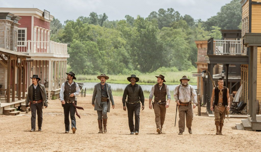"Byung-hun Lee, from left,  Manuel Garcia-Rulfo, Ethan Hawke, Denzel Washington, Chris Pratt, Vincent D'Onofrio and Martin Sensmeier appear in a scene from ""The Magnificent Seven."" (Sam Emerson/Sony Pictures via AP)"