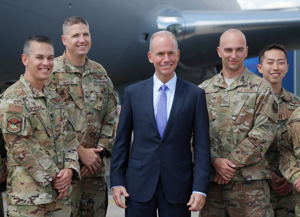 Boeing Chief Executive Dennis Muilenburg posed Monday with crew members of a Boeing KC-46 tanker at the Paris Air Show  in Le Bourget, northeast of Paris. Boeing executives apologized Monday to airlines and families of victims of 737 Max crashes in Indonesia and Ethiopia, as the U.S. plane maker struggles to regain the trust of regulators, pilots and the global traveling public. A KC-46 tanker in the background.