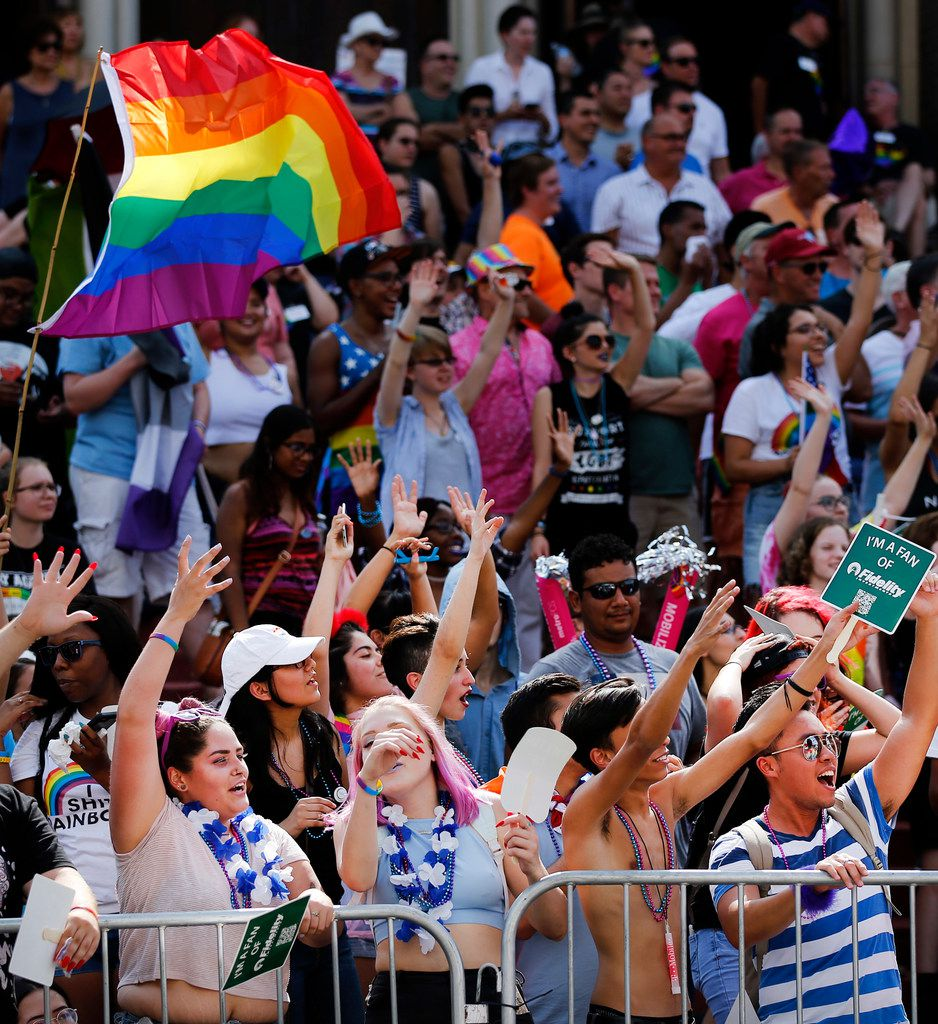 People gathered along the street outside Oak Lawn United Methodist Church to watch the pride parade.