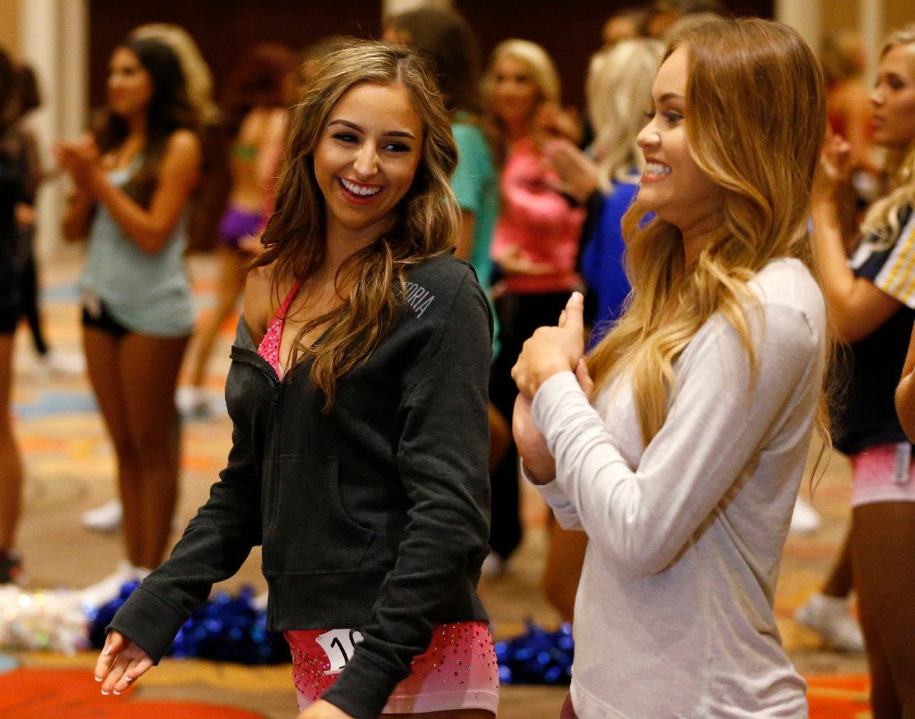 Leah Payne of San Antonio smiles at Elaney Dominguez of San Antonio after they both made it past the first cut during the first day of the Dallas Mavericks Dancers auditions at the Hilton Anatole in Dallas on Saturday, July 15, 2017.