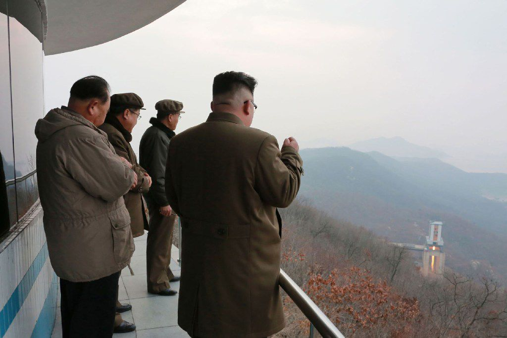 This undated photo released Sunday by North Korea's official Korean Central News Agency shows North Korean leader Kim Jong Un (right) inspecting the ground jet test of a newly developed high-thrust engine at the Sohae Satellite Launching Ground.