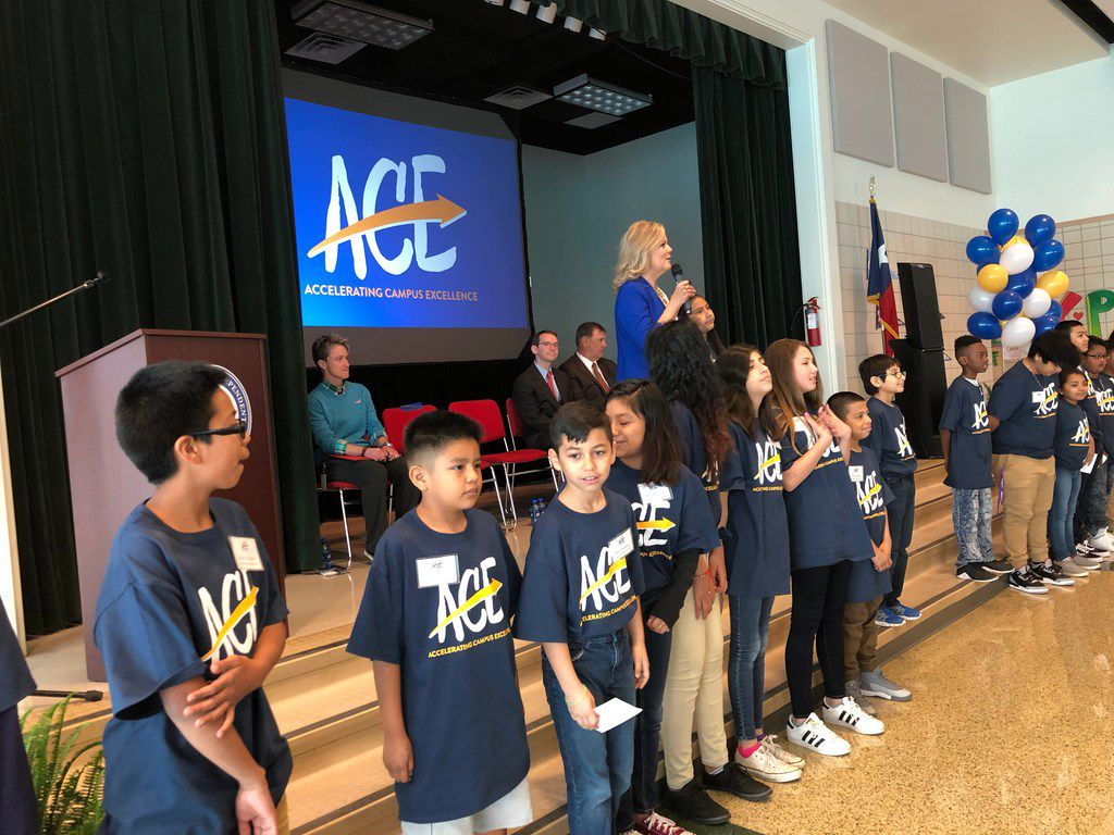Richardson ISD superintendent Jeannie Stone, with a group of students from Carolyn G. Bukhair Elementary, presents her district's plan to launch a new turnaround program patterned after Dallas ISD's Accelerating Campus Excellence plan next year.