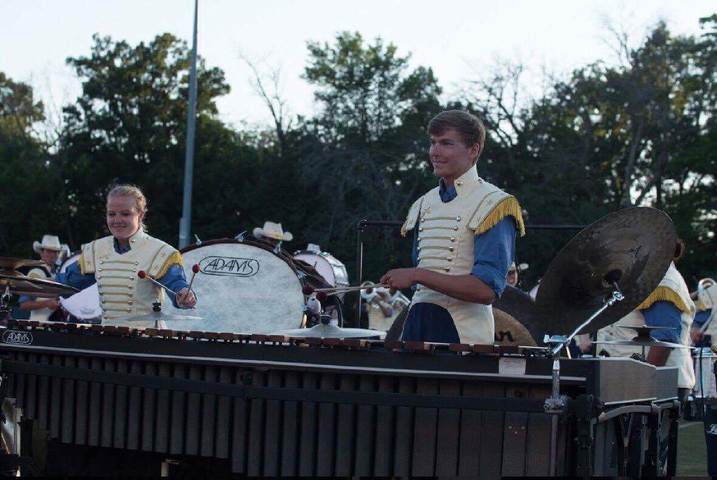 Jacob Hord (right) plays marimba during the Troopers DCI show.