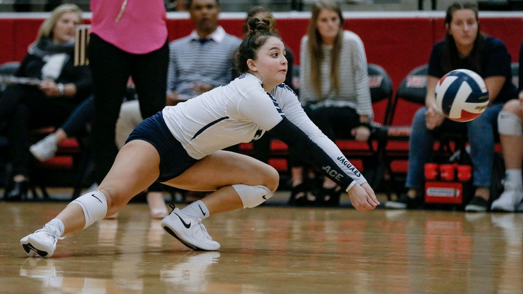 Flower Mound defensive specialist Sarah Martinez digs the ball during a Class 6A area-round playoff victory over Mansfield on Thursday. (Brandon Wade/Special Contributor)