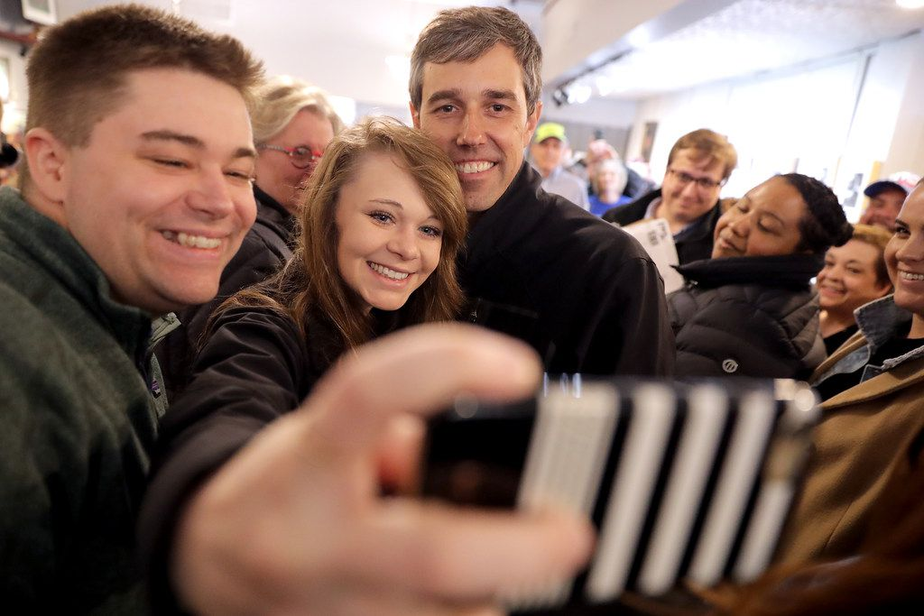 Democratic presidential candidate Beto O'Rourke poses for photographs with supporters during his second day of campaigning for the 2020 nomination at Art Domestique on March 15 in Washington, Iowa. After losing a long-shot race for U.S. Senate to Republican incumbent Ted Cruz, the 46-year-old O'Rourke is making his first campaign swing through Iowa after jumping into a crowded Democratic field this week.