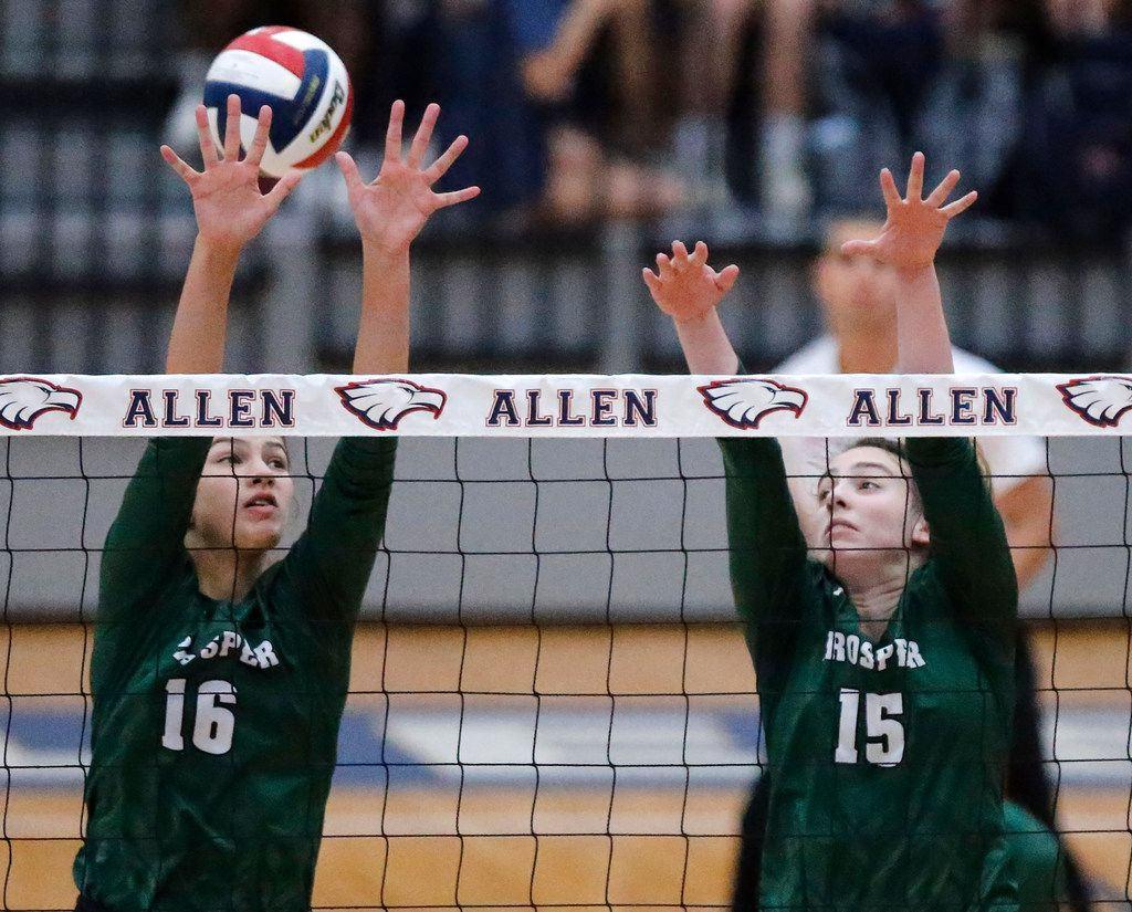 Prosper High School middle blocker Taylor Youtsey (16) and Prosper High School outside hitter Nikki Steinheiser (15) attempt to make a block during game two as Allen High School hosted Prosper High School in a District 9-6A volleyball match in Allen on Tuesday, October 1, 2019. (Stewart F. House/Special Contributor)
