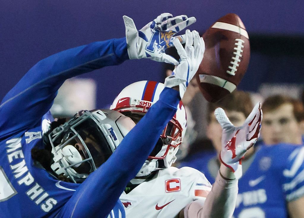 Memphis defensive back Chris Claybrooks (7) breaks up a pass intended for ]SMU wide receiver James Proche (3) during the second half of an NCAA football game at Liberty Bowl Memorial Stadium on Saturday, Nov. 2, 2019, in Memphis, Tenn. (Smiley N. Pool/The Dallas Morning News)