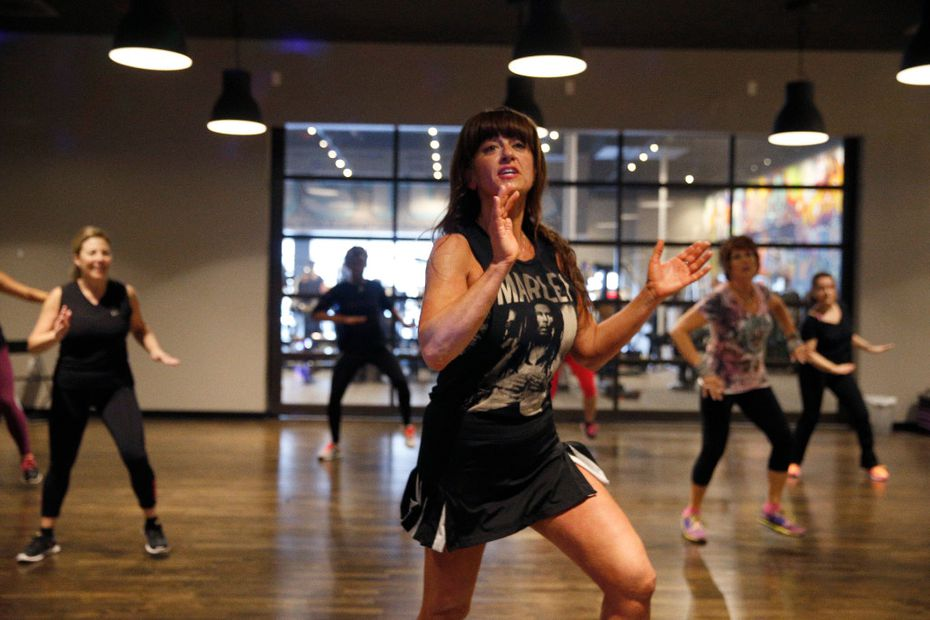 Brandi Farris group fitness director leads a Zumba class.  (Nathan Hunsinger/The Dallas Morning News)