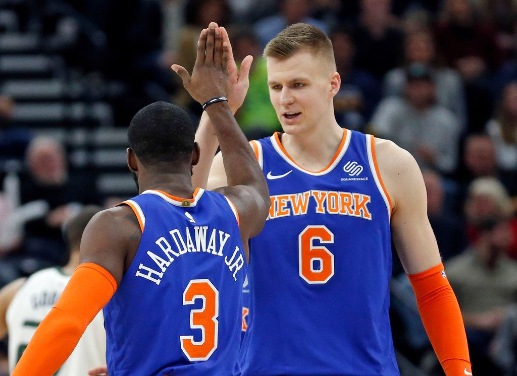 New York Knicks' Tim Hardaway Jr. (3) receives a high-five from Kristaps Porzingis (6) after scoring a 3-pointer against the Utah Jazz during the second half during an NBA basketball game Friday, Jan. 19, 2018, in Salt Lake City. (AP Photo/Rick Bowmer)