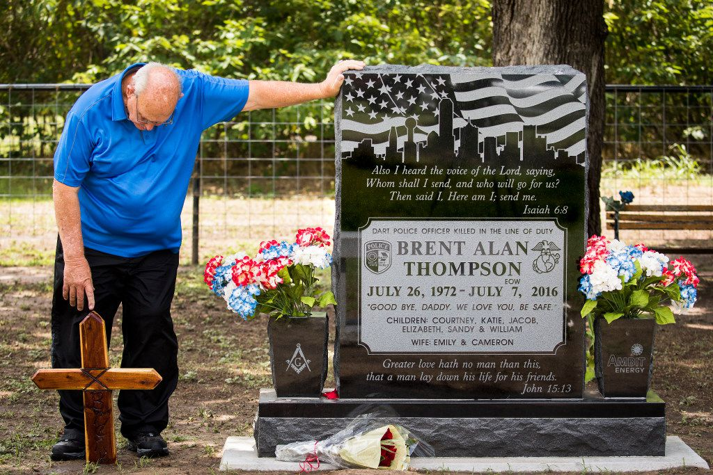 Sam Thompson visits the grave of his son, DART police Officer Brent Thompson. The grave is the first in a family cemetery built on the site of Sam Thompson's childhood home. Growing up, Brent Thompson and his two brothers used to camp, fish and hunt there.