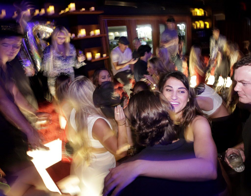 Guests enjoy the drinks and music at Sidebar in Dallas, TX, on Sep. 19, 2015. (Jason Janik/Special Contributor)