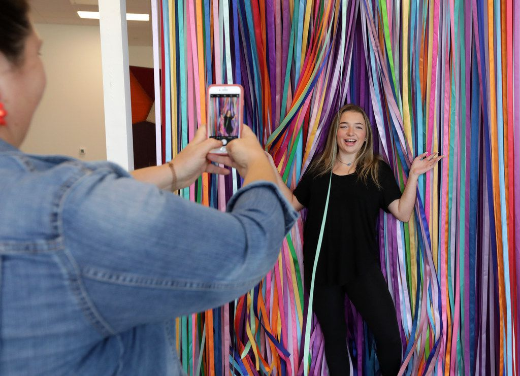 Snap151's Dawn Snodgrass, left, takes a photograph of Makayla McCarter at the Snap151 pop-up photo studio in Frisco,.
