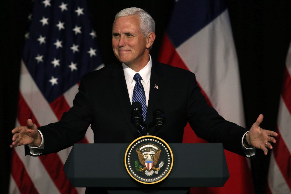In the file photo, Vice President Mike Pence gestures as he delivers a speech during a business dinner in Santiago, on August 16.