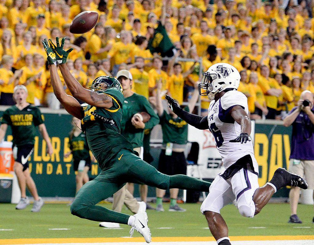 Baylor wide receiver R.J. Sneed, left, scores past Stephen F. Austin cornerback Eli Jones (26), right, in the second half of an NCAA college football game in Waco, Texas, Saturday, Aug. 31, 2019. (Rod Aydelotte/Waco Tribune-Herald via AP)