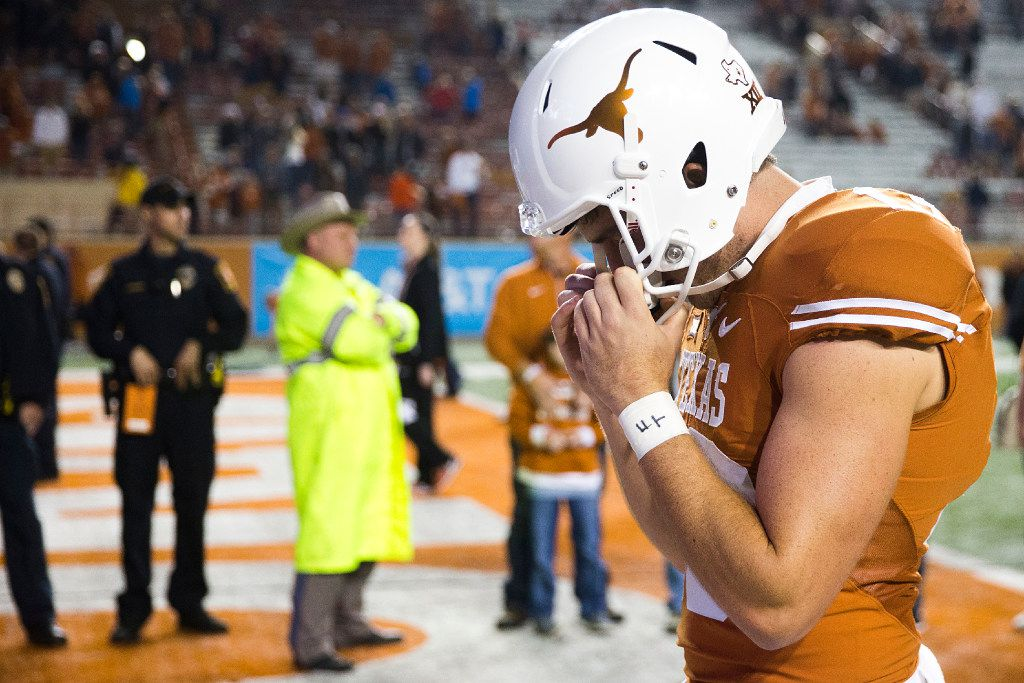 Texas punter Michael Dickson clutches his facemask as he walks off the field after a loss to TCU in an NCAA football game at Darrell K Royal ÐTexas Memorial Stadium on Friday, Nov. 25, 2016, in Austin. TCU won the game 31-9.  The Longhorns finished the season 5-7.  (Smiley N. Pool/The Dallas Morning News)