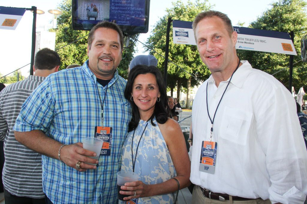 Former Dallas Cowboys players Mike Kiselak (left) and Chad Hennings (right) with Chad's wife Tammy at Taste of the NFL.