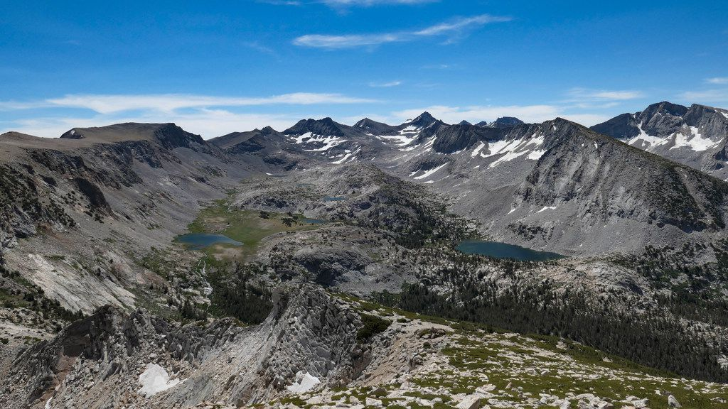 The view from atop Vogelsang Peak in Yosemite National Park is stunning, with lakes and deep valleys.