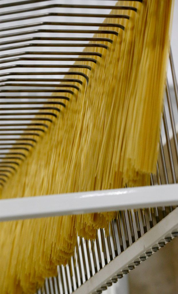 Cooked pasta on an assembly line at La Moderna in Cleburne.