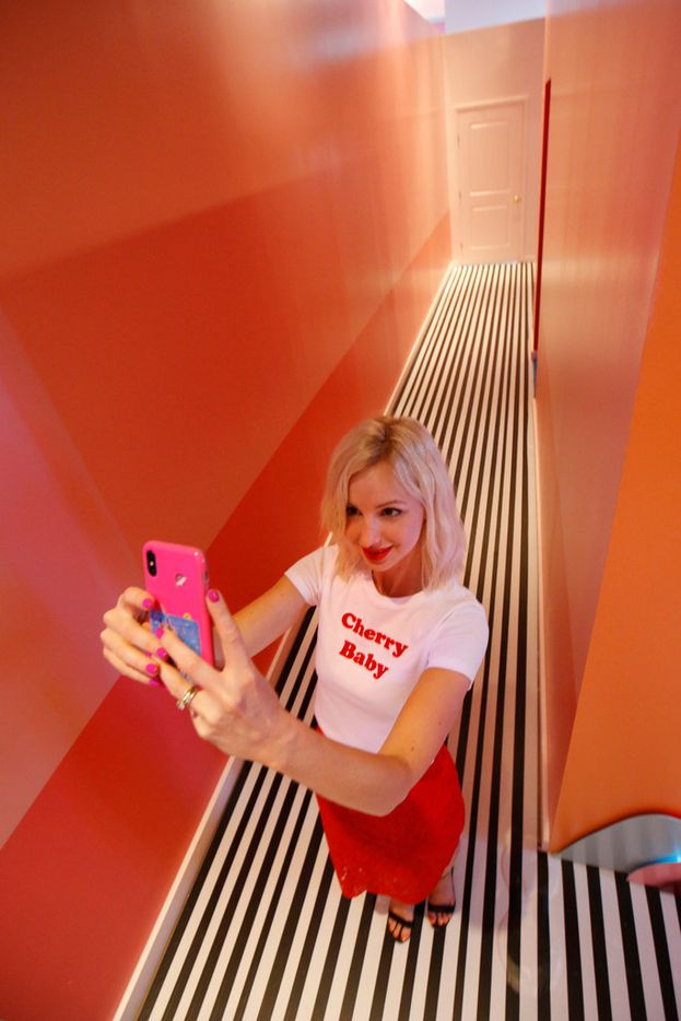 Nancy Davis takes a selfie at Sweet Tooth Hotel, an experimental art an retail pop up in Dallas.