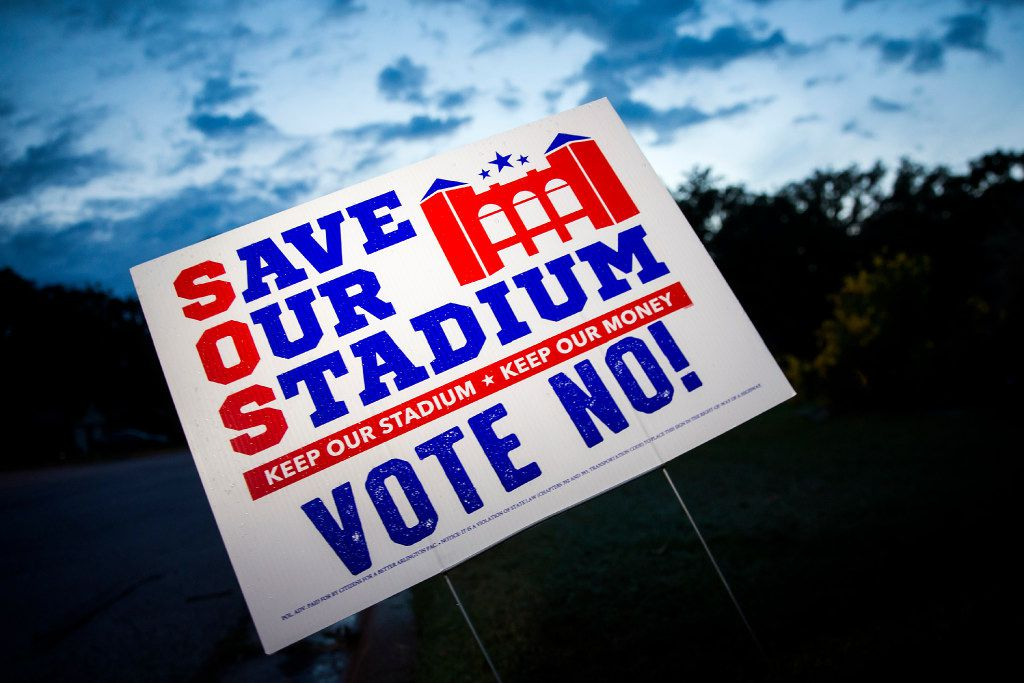 Yard signs expressing opposition to a proposal to build a $1 billion retractable-roof stadium for the Texas Rangers are seen in a residential neighborhood on Oct. 1 in Arlington.