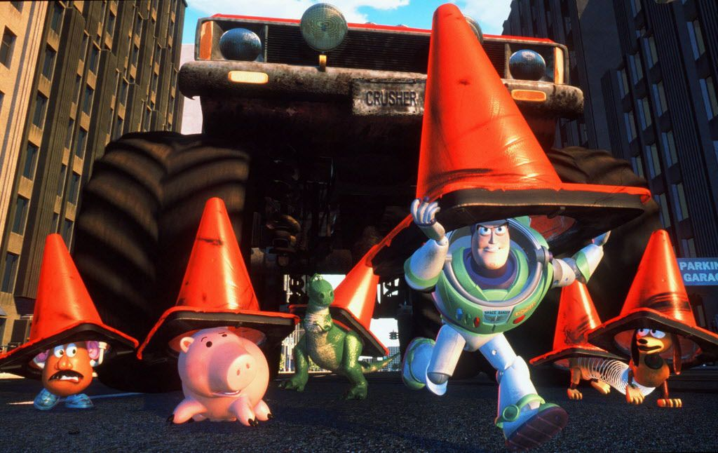 Using orange cones for camouflage, Buzz Lightyear leads the toys from Andy's room on a mission to rescue their toynapped pal, Woody, in Disney/Pixar's computer animated comedy-adventure, 'Toy Story 2.'