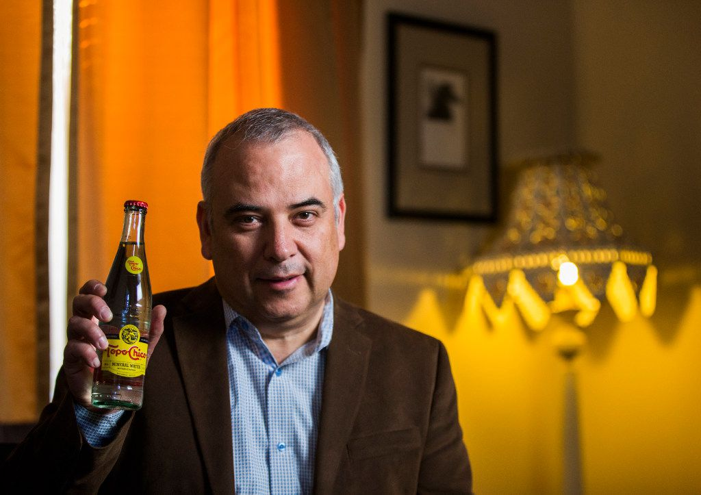 Gerardo Galvan, general manager of Mexican beverage manufacturing and distribution company Arca Continentalon, poses for a portrait with a bottle of Topo Chico on Friday, January 20, 2017 at his home in Coppell, Texas. Galvan is credited for bringing the carbonated water drink to Texas. (Ashley Landis/The Dallas Morning News)