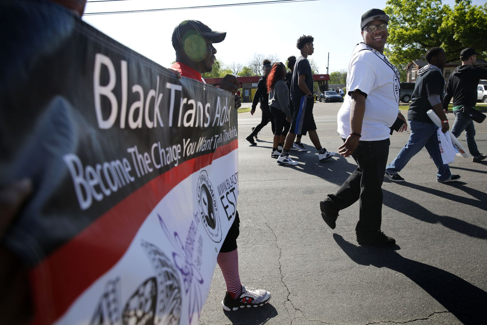 Trenton Johnson (far right), a transgender man, participates in the AIDS Walk South Dallas with other Black Trans Advocacy Coalition members near the Martin Luther King, Jr. Community Center in South Dallas on Saturday, March 25, 2017.