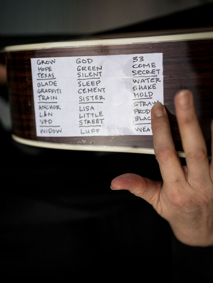 Michelle Shocked's Mercury Trilogy set list taped on her guitar.