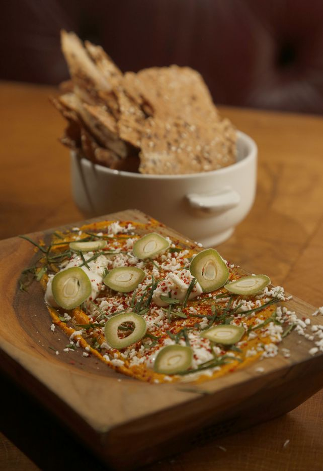 Smoked carrot dip with green almonds and fresh sour cream