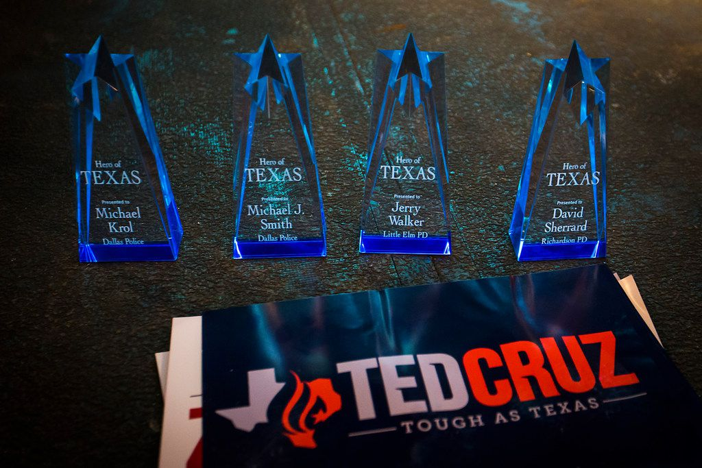 Rememberances for the families of fallen law enforcement officers rest on the stage during a campaign event for  Sen. Ted Cruz at River Ranch Stockyards on Wednesday, April 4, 2018, in Fort Worth, Texas.