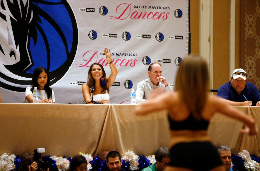 Dallas Mavericks Dancers director Mallory Mills signals for the next dancer as dancers perform during the first day of Dallas Mavericks Dancers auditions at the Hilton Anatole in Dallas on Saturday, July 15, 2017.