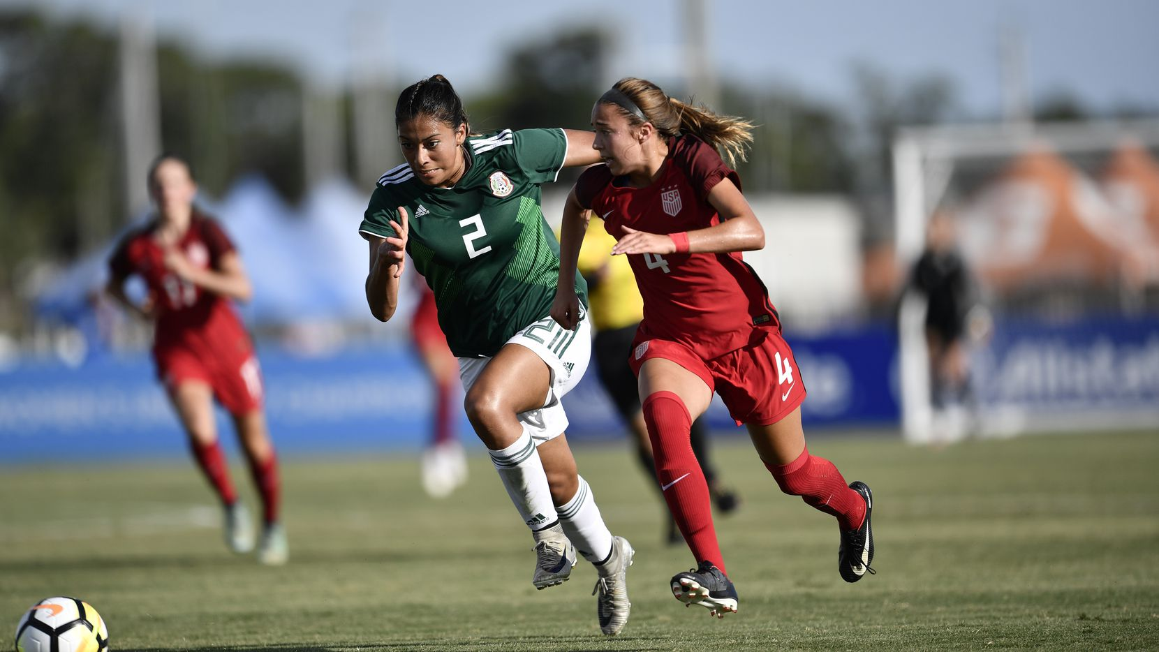 June 12, 2018 (Bradenton, FL) - Mexico's Reyna Reyes contests a loose ball with the USA's Talia DellaPeruta. The US would win the Concacaf Women's U17 Championship final 3-2.