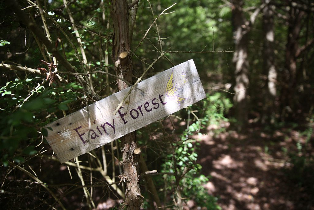 A sign marks a trail where guests can walk and find various objects hidden in the trees at Savannah's Meadow