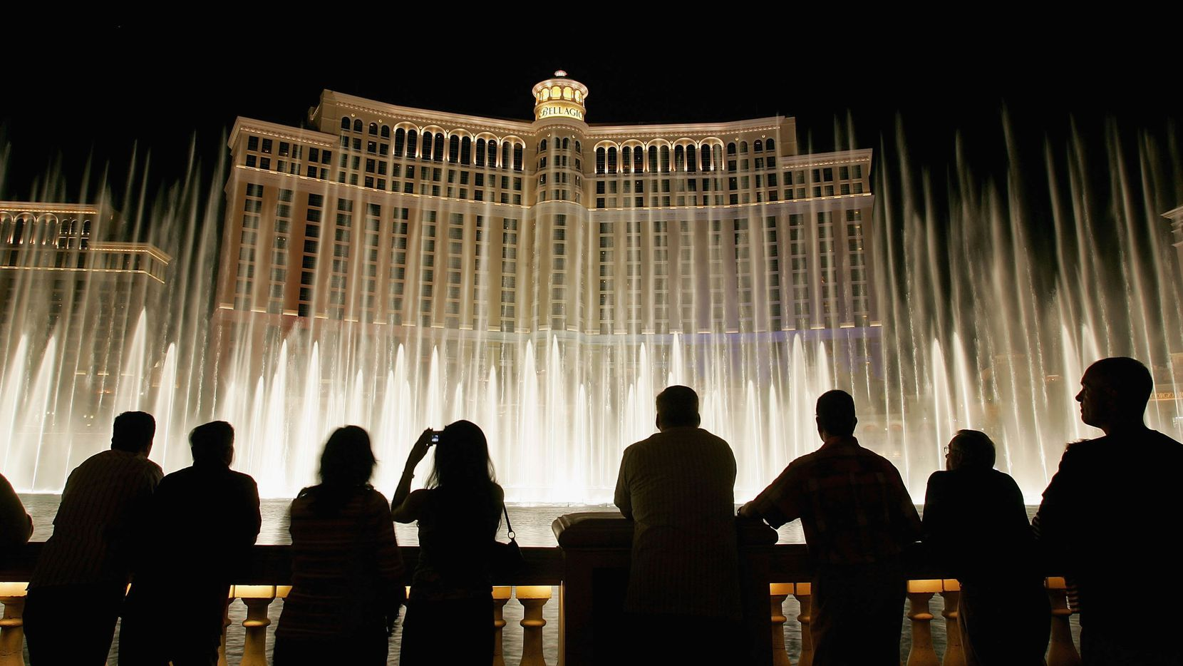Tourists are silhouetted as they watch the Bellagio fountain show on the Las Vegas Strip in October 2005 in Las Vegas.