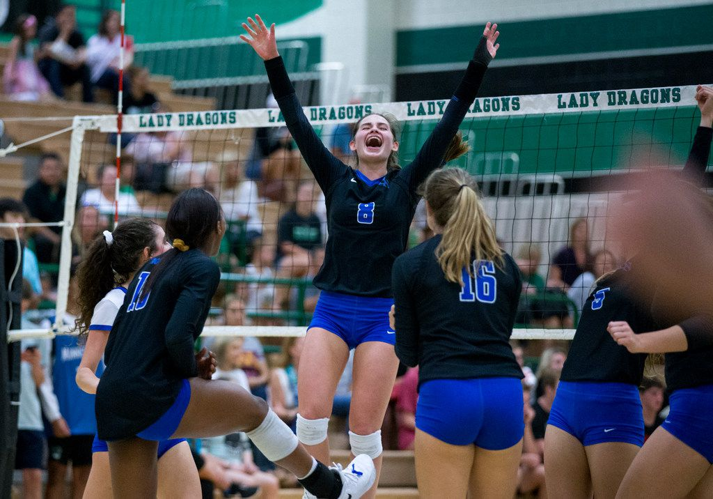 Trophy Club Byron Nelson outside hitter Paige Flickinger (8) celebrates with her teammates during a match against Southlake Carroll on September 18, 2018. (Shaban Athuman/ The Dallas Morning News)
