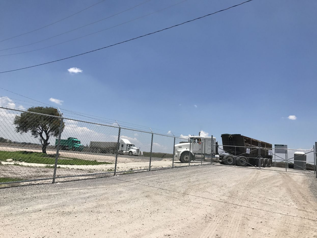 Trucks drive in and out of the Toyota plant under construction in the central state of Guanajuato, Mexico.
