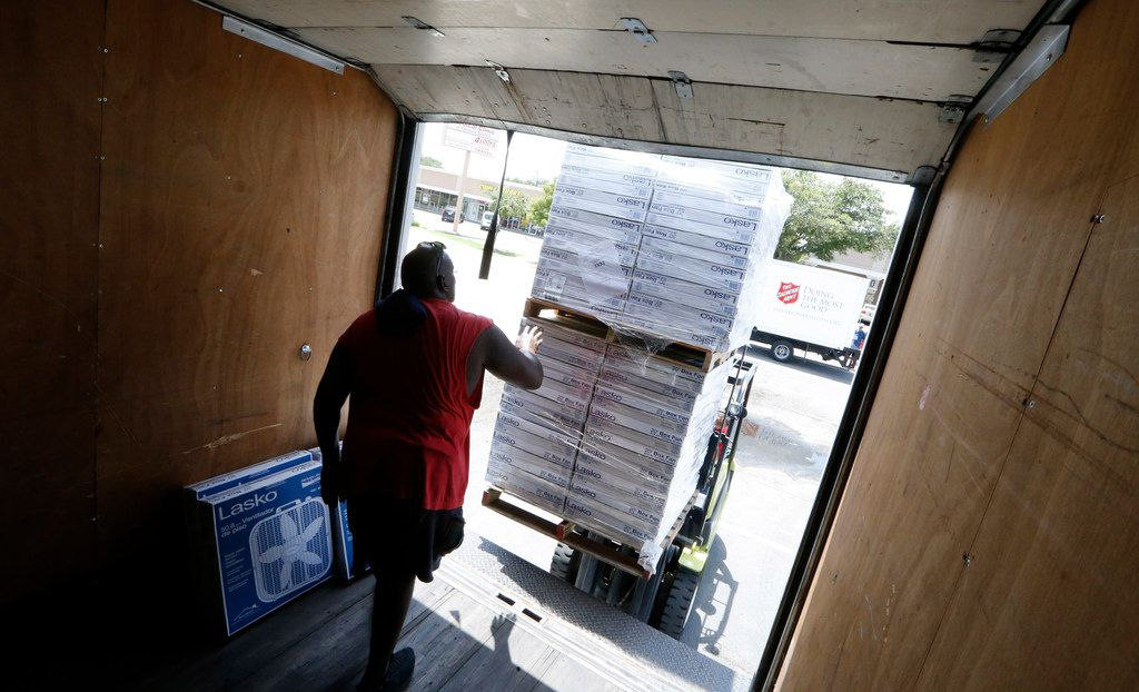 Robert Sheppard of The Salvation Army loaded up donated fans organized at Westlake ACE Hardware in Farmers Branch in July 18, 2018. Atmos has donated $1.5 million to the Salvation Army DFW Metroplex Command.