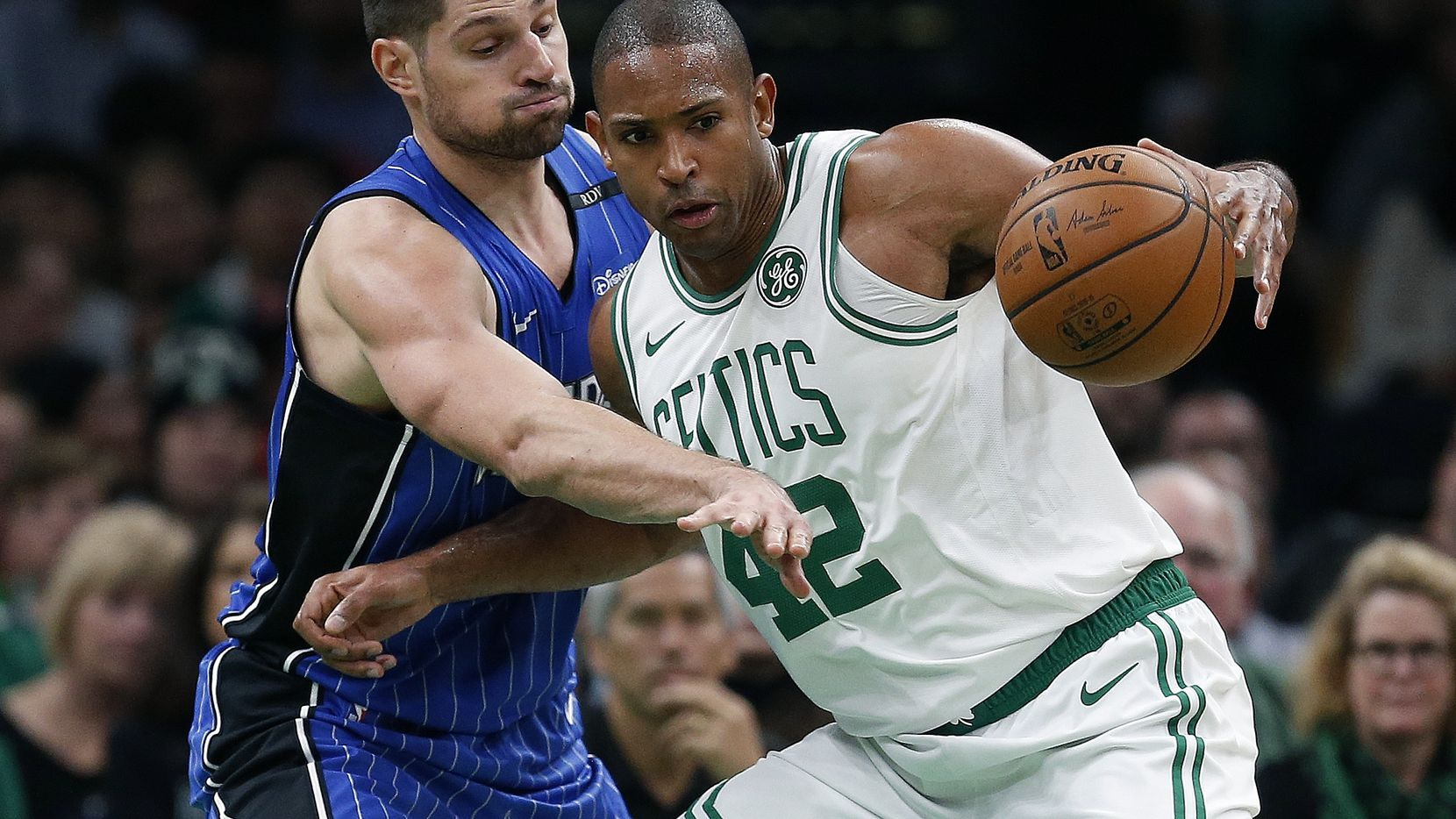 Orlando Magic's Nikola Vucevic, left, defends against Boston Celtics' Al Horford (42) during the second half of an NBA basketball game in Boston, Monday, Oct. 22, 2018. (AP Photo/Michael Dwyer)