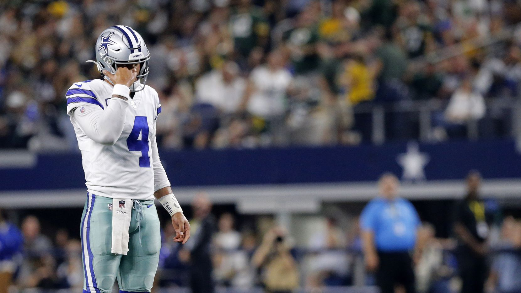 Dallas Cowboys quarterback Dak Prescott (4) waits for officials to sort out a penalty flag against the Cowboys against the Green Bay Packers at AT&T Stadium in Arlington, Texas, Sunday, October 6, 2019.
