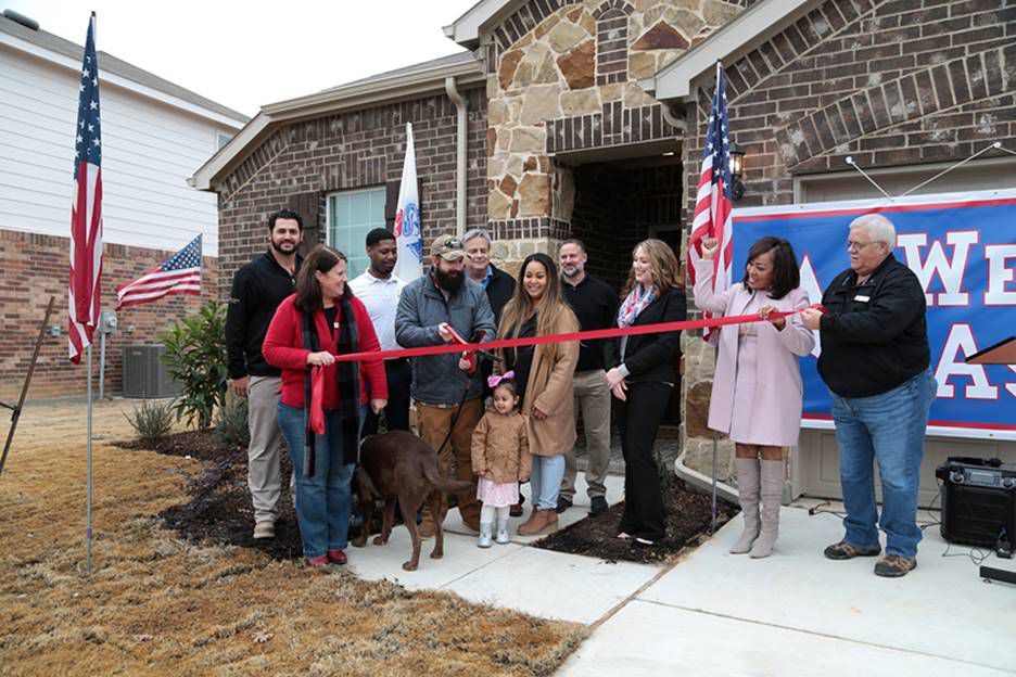 U.S. Army Specialist Joshua Ashby, his wife and children received the keys to move into a new, custom-built, mortgage-free home. Funded in part by a $7,000 HAVEN grant from the Federal Home Loan Bank of Dallas and Texas Capital Bank, the grant helped offset the cost of their home, working in conjunction with Operation FINALLY HOME, a nonprofit dedicated to honoring American veterans with custom-built, mortgage-free homes.  Photo from Federal Home Loan Bank of Dallas.