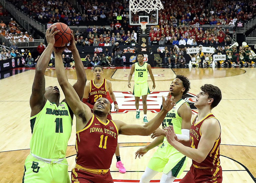 KANSAS CITY, MISSOURI - MARCH 14:  Mark Vital #11 of the Baylor Bears and Talen Horton-Tucker #11 of the Iowa State Cyclones compere for a rebound during the quarterfinal game of the Big 12 Basketball Tournament at Sprint Center on March 14, 2019 in Kansas City, Missouri. (Photo by Jamie Squire/Getty Images)