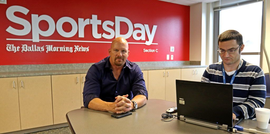 """WWE Hall of Famer """"Stone Cold"""" Steve Austin, left, chats with Mark Francescutti at The Dallas Morning News on Nov. 5, 2015."""