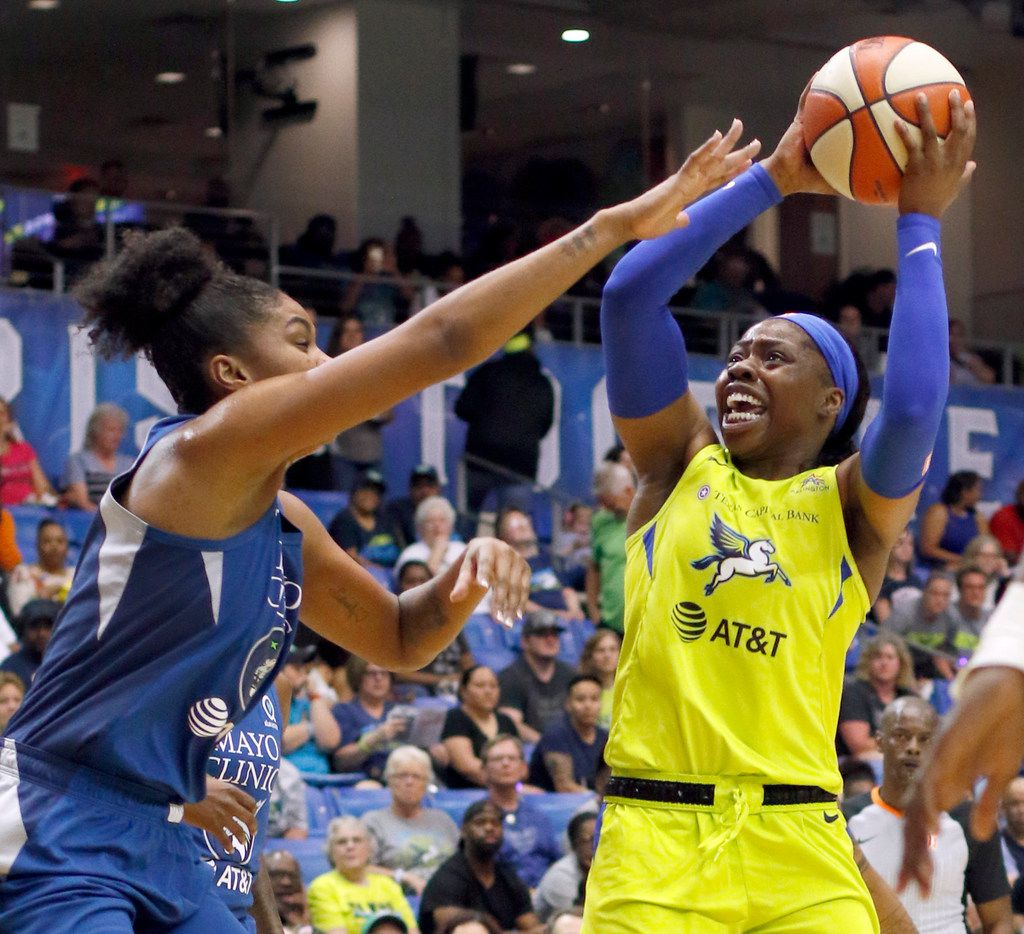 Dallas Wings guard Arike Ogunbowale (24) shoots a jump shot over the defense of Minnesota Lynx forward Damiris Dantas (92) during first half action. The Wings hosted the Minnesota Lynx in their season home opener at UT-Arlington's College Park Center in Arlington on June 1, 2019. (Steve Hamm/ Special Contributor)