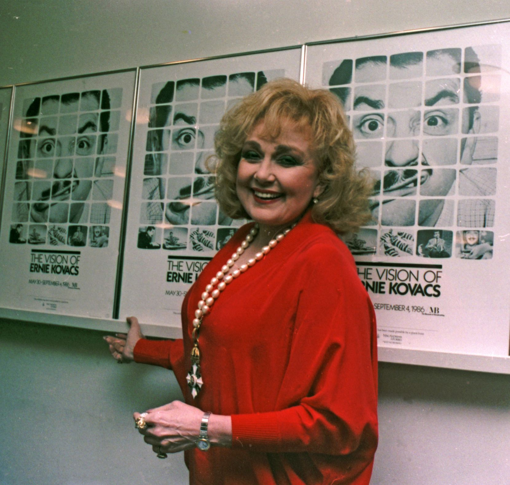 Edie Adams, the widow of Ernie Kovacs, stands next to posters of Kovacs in New York following a seminar on the work of Kovacs in this 1986 file photo. Adams, who won a Tony Award for bringing Daisy Mae to life on Broadway and was television foil for her husband, Ernie Kovacs, died Wednesday Oct. 15, 2008, in a Los Angeles hospital from pneumonia and cancer, publicist Henri Bollinger said. She was 81.